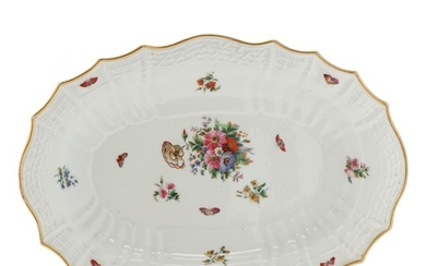 The Imperial Porcelain Factory 1825–1855: A Russian porcelain dish, decorated in colours and gold. Cyrillic mark H I for Tsar Nicholas I of Russian. L. 39 cm.