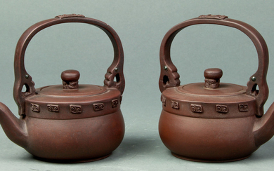 (lot of 2) A pair of handled Yixing Teapots