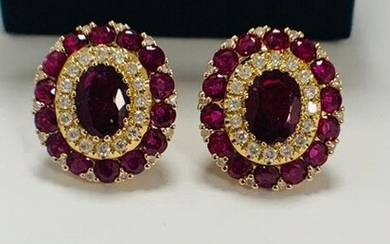 14ct Rose Gold Ruby and Diamond stud earrings featuring, 2 oval cut Rubies (1.47ct TSW), claw set, with 60 round cut Rubies (1.99ct TSW), claw set, and 60 round brilliant cut Diamonds (0.39ct TDW), claw set.