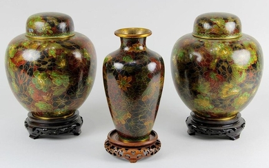 3 Cloisonné vases, China mid-20th century: Pair of lidded vases and 1 vase, all with very similar decoration of flowers on reddish brown background, on round wooden stands, H lidded vases each 20.5 cm, vase 20 cm. 2483-018
