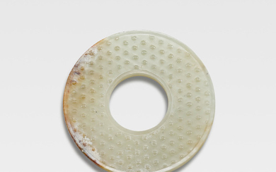 A white and russet jade disc, huan