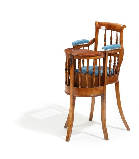 A 19th century polished beech and fruit wood children's chair with removeable table top.