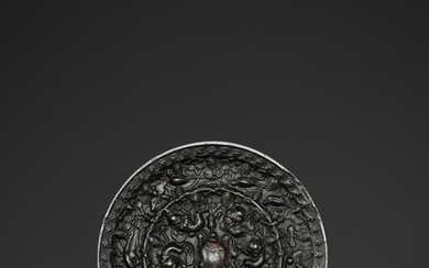 A BRONZE 'LION AND GRAPEVINE' MIRROR, TANG DYNASTY