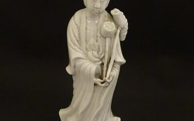 A Chinese blanc de chine figure of Guanyin holding