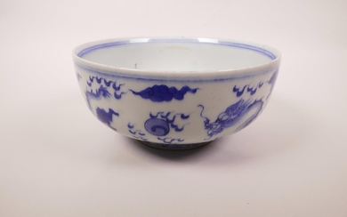 A Chinese blue and white porcelain bowl decorated with a dra...