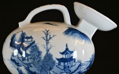 A Chinese ovoid ewer, decorated in tones of blue and white w...