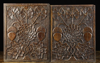 A Fine Pair of 17th Century Carved Oak Panels richly decorated with a stylised flower bloom of layer
