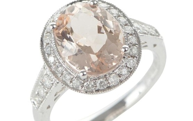 A MORGANITE AND DIAMOND CLUSTER RING IN 18CT WHITE GOLD, THE OVAL CUT MORGANITE WEIGHING 3.14CTS, BORDERED BY DIAMONDS TOTALLING 0.3...