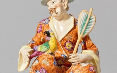 A Meissen porcelain figure of a seated pagode with a parrot
