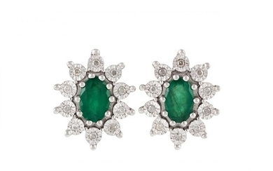 A PAIR OF DIAMOND AND EMERALD CLUSTER EARRINGS, of oval form...