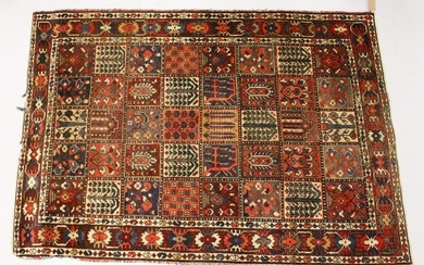 A PERSIAN RUG, 20TH CENTURY, the central field with