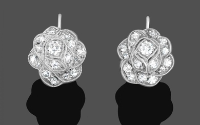 A Pair of Diamond Cluster Earrings, the floral motifs set...