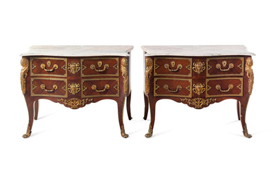 A Pair of Régence Style Gilt Bronze Mounted Marble-Top Commodes