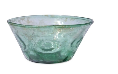 * A SMALL GREEN MOULD-BLOWN CLEAR-GLASS BOWL Iran, 10th - 12th century