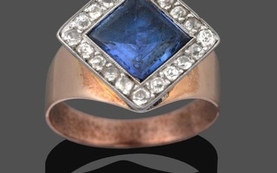 A Sapphire and Diamond Cluster Ring, the step cut sapphire...