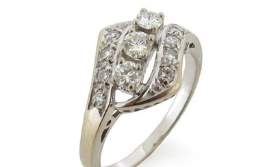 A diamond cluster ring, the three graduated round brilliant-cut diamonds are set within a diamond crossover surround in white gold, size R