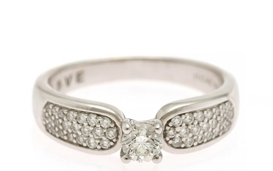 A diamond ring set with a diamond weighing app. 0.30 ct. flanked by numerous diamonds, totalling app. 0.60 ct., mounted in 14k white gold. F-G/VS-SI. Size 57.