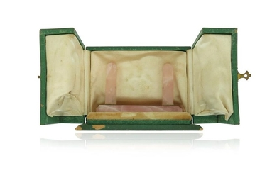 A green leather watch case by Cartier, containing...