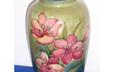 A large Moorcroft pottery vase decorated with red lilies; p...