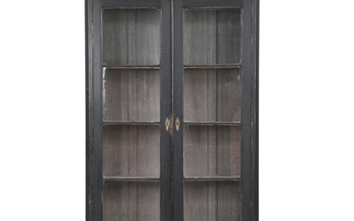 A large black painted vitrine cupboard, front with a pair of glass doors enclosing shelves....