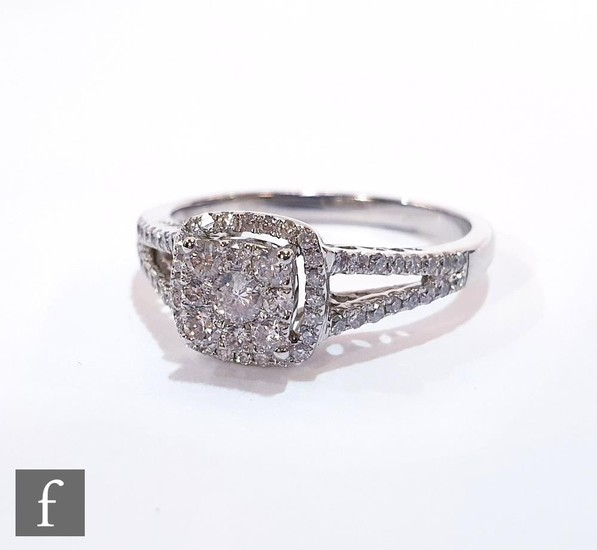 A modern 9ct hallmarked white gold diamond cluster ring, cen...