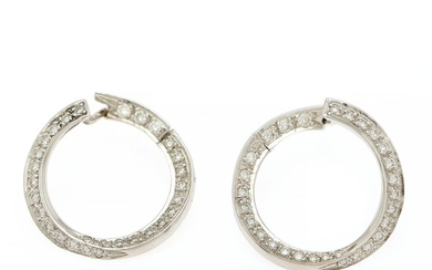 A pair of diamond ear pendants each set with numerous brilliant-cut diamonds totalling app. 0.98 ct., mounted in 18k white gold. Diam. app. 22 mm. (2)