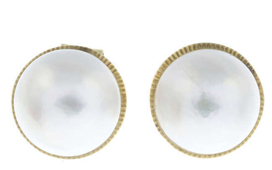 A pair of mabe pearl earrings.
