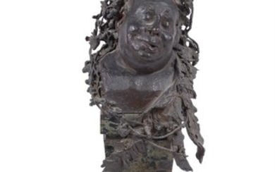 A patinated bronze bust of Bacchus