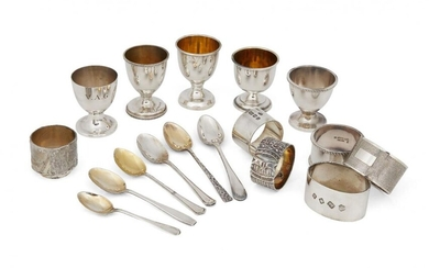 A quantity of silver eggcups and napkin...