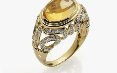 A ring with citrine and brilliant cut diamonds
