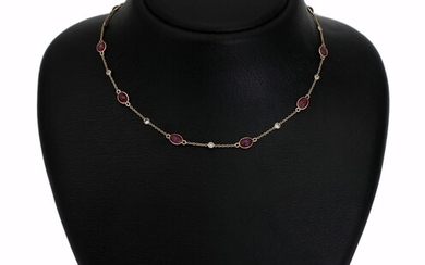 A ruby and diamond necklace set with numerous rubies and diamonds, mounted in 14k gold....