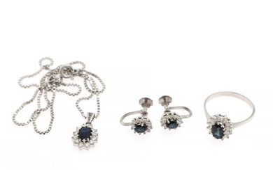 A sapphire and diamond jewellery set comprising a ring, a pendant and a pair of ear screws each set with a sapphire and diamonds, mounted in 14k white gold. (5)