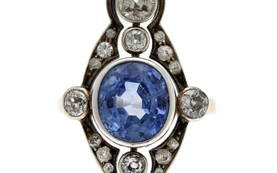 NOT SOLD. A sapphire and diamond ring set with a sapphire encircled by numerous diamonds,...