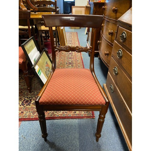 A set of six mahogany bar back dining chairs, each with hori...