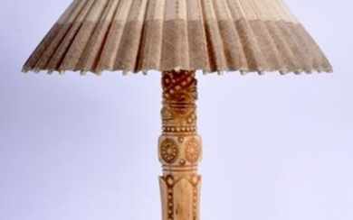 AN EARLY 20TH CENTURY EASTERN CARVED IVORY PARASOL