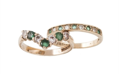 AN EMERALD AND DIAMOND HALF ETERNITY RING mounted in 9ct gol...