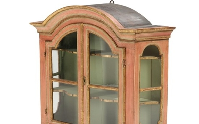 An 18th century painted Baroque wall display cabinet, curved top, front with two vitrine doors. H. 79. W. 94. D. 28 cm.