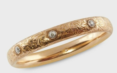 An Art Nouveau diamond and fourteen karat gold bangle