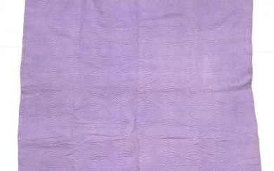 An Early 20th Century Wholecloth Quilt, with mauve on one...