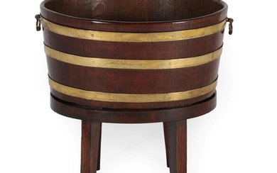 An Oak and Brass Bound Oval Wine Cooler, of staved...