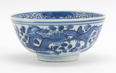 """CHINESE BLUE AND WHITE PORCELAIN BOWL With a four-clawed dragon design. Four-character Kangxi mark on base. Height 2.75"""". Diameter 5..."""