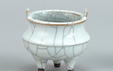 """CHINESE GUAN WARE PORCELAIN CENSER Ovoid, with rectangular handles and tripod base. Diameter 3.5""""."""