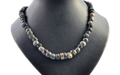 Eastern Mediterranean Basin Vitreous stone beads and stones Beaded necklace with gold clasp.