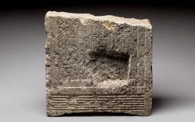KINGDOM OF SABA STEL in limestone with architectural decoration and Sudarabic inscription. Four lines preserved as well as the beginning of the fifth. Kingdom of Sheba, circa 600 BC to 300 AD Height 40, Width 41.5 Depth 13.5 cm (accidents, reuse (?)...