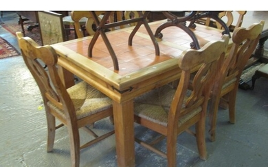 Modern pine kitchen table inset to the top with tiles, toget...