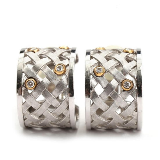 Ole Lynggaard: A pair of braided diamond ear clips set with numerous brilliant-cut diamonds, mounted in 14k gold and white gold. Diam. 2 cm. (2)