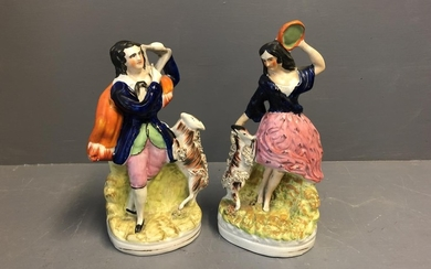 Pair of Staffordshire flatback of figures with goats 25 cm