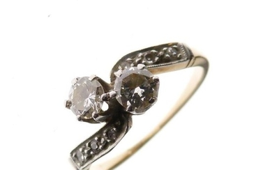 Unmarked yellow metal and diamond dress ring of crossover...