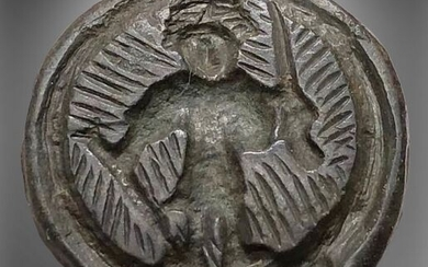 Viking Bronze Seal with an image of a Warrior holding a Sword in his right hand and the Sheath in the other hand
