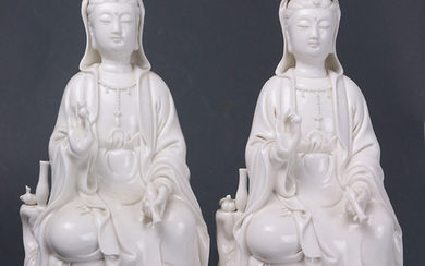 (lot of 2) A pair of seated Dehua Guanyin figures